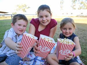 MOVIE NIGHT: Dirranbandi Miss Showgirl 2016 Amber Stewart with locals such Cooper Harman, 6, and Charlotte Stephens, 5.