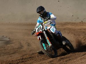 BURNING RUBBER: Joel Evans rips around the track at a motocross club day in Chinchilla on Sunday.