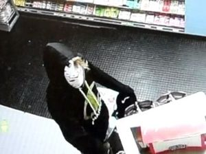 CCTV shows a man breaking into the Friendly Grocer supermarket at Peregian Beach.