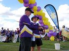 OFF AND WALKING: Faces of the Miles 2016 Relay for Life Graham Small and Bill Hart cut the ribbon to officially open the relay on Saturday afternoon.