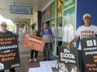 PROTEST: Stephen Fletcher, Sharryn Usher, Darryl Chaffey and Robert Usher perform a stunt outside Kevin Hogan's Office.