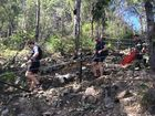 A MAN in his 50s who suffered head and arm injuries in a 3m fall on Mt Tibrogargan has been airlifted form the mountain.