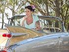 CHERRY CADILLAC:  Rockville woman Kristy Clark also known as Miss Cherry Princess in Les Holt's 1959 cadillac Eldorado.