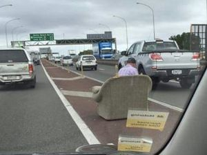 Man snapped sitting on couch in the middle of the road