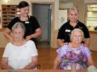 PROUD PAMPERING: CQUniversity beauty therapy students Amy McKee and Kylie Medlin treat Benevolent Home residents to a relaxing massage.