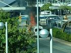 A maxi taxi on fire at Brisbane Airport. PIC: Kylie Collins via Twitter
