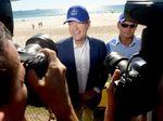Opposition leader Bill Shorten tries on a hat from Cudgen Surf Life Saving Club in Kingscliff on Sunday, May 15, 2016.