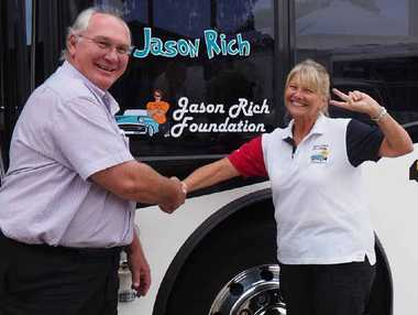NEW NAME: Young's Bus Service Operations Manager Phil Young with Tracey Rich after the bus service put a call out to the community wanting suggestions to name their entire bus fleet. Their latest bus to be named is now called Jason Rich.