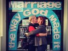 AN iconic photograph of two lesbians kissing in front of a Russell St store has gone viral online.