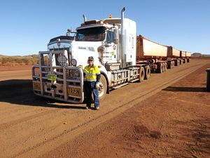 HARD YAKKA: Toowoomba grandma Ruth Richardson swapped the office to drive four-trailer road trains in Port Hedland, Western Australia.