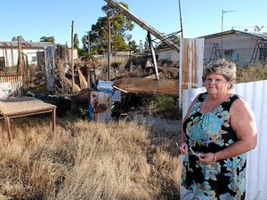 IRATE: Wendy Rankin outside the remains of the house at 2 Binnie St, Tara, which has remained untouched since the day it burned down.