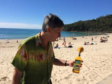 Peter Daley takes a reading on Noosa Main Beach.