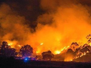 BLAZING: Wayne Hawes captures this image of a fire on a hill near Douglas McInnes Dr, Laidley.