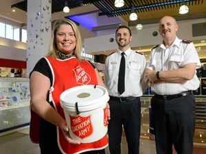 HELPING OUT: Bendigo Bank's Tracey Thompson helps Salvation Army leaders Ben Johnson and Greg Pack collect for the Red Shield Appeal at Riverlink Shopping Centre.