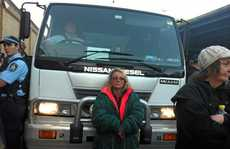 ON THE LINE: Sharryn Usher blockades one of the Corrective Services vehicles cross the picket line around Grafton jail to remove prisoners.