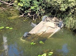 A mother had to revive her young daughter after pulling her from a car wreck submerged in Running Creek. The car had flipped off the notorious bridge on Brooweena Woolooga Rd.