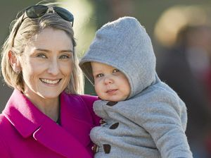 COLD SNAP: Rebecca Howse and 16-month-old Cooper Howse rug up to watch Cooper's father Matty Howse play for Roma against USQ in the Risdon Cup at USQ at the weekend.
