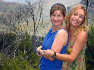 Cindy Waldron (left) and Leeann Mitchell swam in a known croc hotspot.
