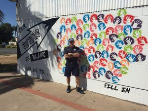 Sergeant Dominic Richardson and the PCYC Blackwater futures wall