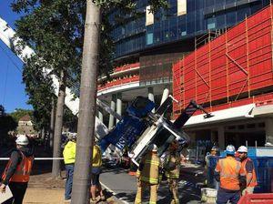 Crane crashes onto building in Brisbane CBD