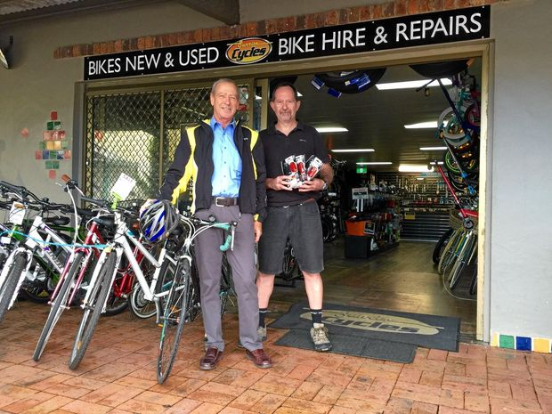 SEE AND BE SEEN: Dr Peter Roger giving away 30 sets of bike lights