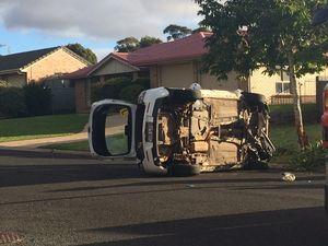 Car flips on suburban street: driver hurt