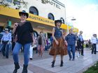 WHAT'S a country music festival without big hats and some boot-scootin'?