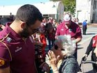 ONE LADY was pushed back by the excited Fan Day crowd on Tuesday, but Greg Inglis came to save the day.