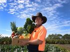 LOCALLY GROWN: Darren Pratt with his box of fresh local produce.Photo: Mike Knott / NewsMail