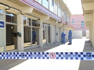 CRIME SCENE: Police tape off an area in the Bundaberg CBD to investigate a serious crime. Photo: Paul Donaldson / NewsMail