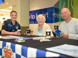JAVA JIVES: Caboolture acting sergeant Clair Parsons has coffee with Joan Plaistow and her son Gary.
