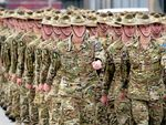 Australian Defence Forces personnel from Force Protection Element 4 (FPE4) and Force Communication Element 3 (FCE3) parade as they are farewelled before deploying to Afghanistan at Gallipoli Barracks in Brisbane, Monday, June 29, 2015. Their deployment is aimed at supporting Australia's force protection mission in Afghanistan. (AAP Image/Dan Peled) NO ARCHIVING
