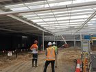 Divison 6 councillor Christian Dickson was given a tour of the new Coles being built at Sippy Downs on Thursday.