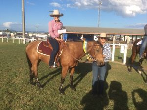 Kendell Davies with her horse Chino during the ribbon presentation at this year's Show Whitsunday.