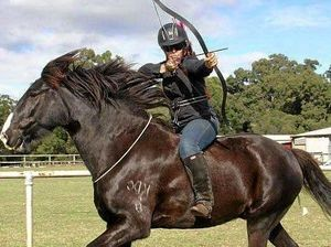 READY, AIM, FIRE: Hayley Larrykin riding bareback bridleless archery.