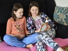 Sisters Jillian Sneedon, 9 (left) and Leena Sneedon (10) are improving their reading skills with help from online reading buddies. June 28, 2016
