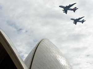 A Qantas A380 (left) and an Emirates A380 performing a fly-over at 1500 feet over the Sydney Opera House, Sunday, March 31, 2013. The fly-over was to mark the partnership between Qantas and Emirates, and is believed to be the first time anywhere in the world where two commercial airline A380's have flown in formation.