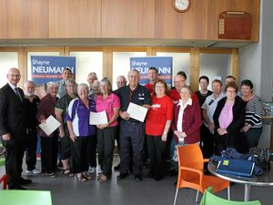 CHEERS TO VOLUNTEERS: Federal Member for Blair Shayne Neumann with local volunteer groups who received funding from the Volunteer Grants Program.