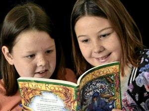 Newtown girls read with confidence thanks to buddies