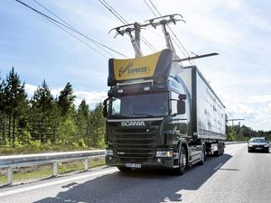 Scania's electric road hybrid truck, Scania G 360 4x2, charging up the world's first electric road.