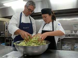 ECHOES RESTAURANT: Chef David Campbell with TAFE student Maggie Wu prepare the Kimchi and Sriracha for the braised Alpaca shoulder.Photo: Mike Knott / NewsMail