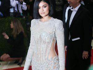 Kylie Jenner and Tyga kiss at Khloe Kardashian's party