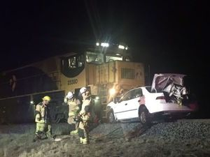 Darling Downs man cheats death as train destroys car