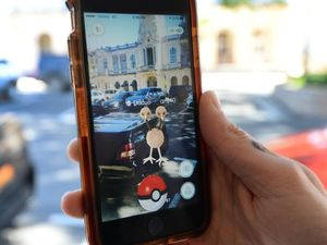 "Phones out ready to ""catch 'em' all"" for new Pokemon game"