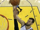 Andrew Bogut has been picked to contest his third Olympics with the Boomers, despite recovering from a knee injury.
