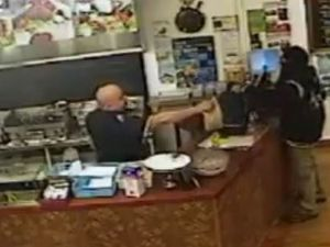 WATCH: How the world's coolest shop owner handles robber