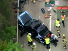 A truck and a Police car have collided on the Pacific Motorway, Gold Coast.