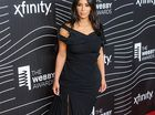 Kim Kardashian West believes she has made her late father proud by appearing on the cover of FORBES magazine.