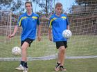 A Gladstone duo has come away very happy from the Queensland Country Soccer selection camp in Townsville