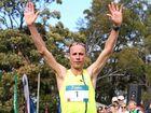 Running legend Steve Moneghetti croosses the line at last year's Running Festival.